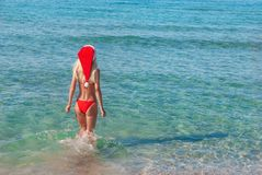 beautiful-blonde-woman-red-christmas-hat-sea-beach-young-new-year-holidays-hot-countries-concept-35363886