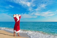 santa-claus-relaxing-sea-beach-sandy-christmas-concept-35363465